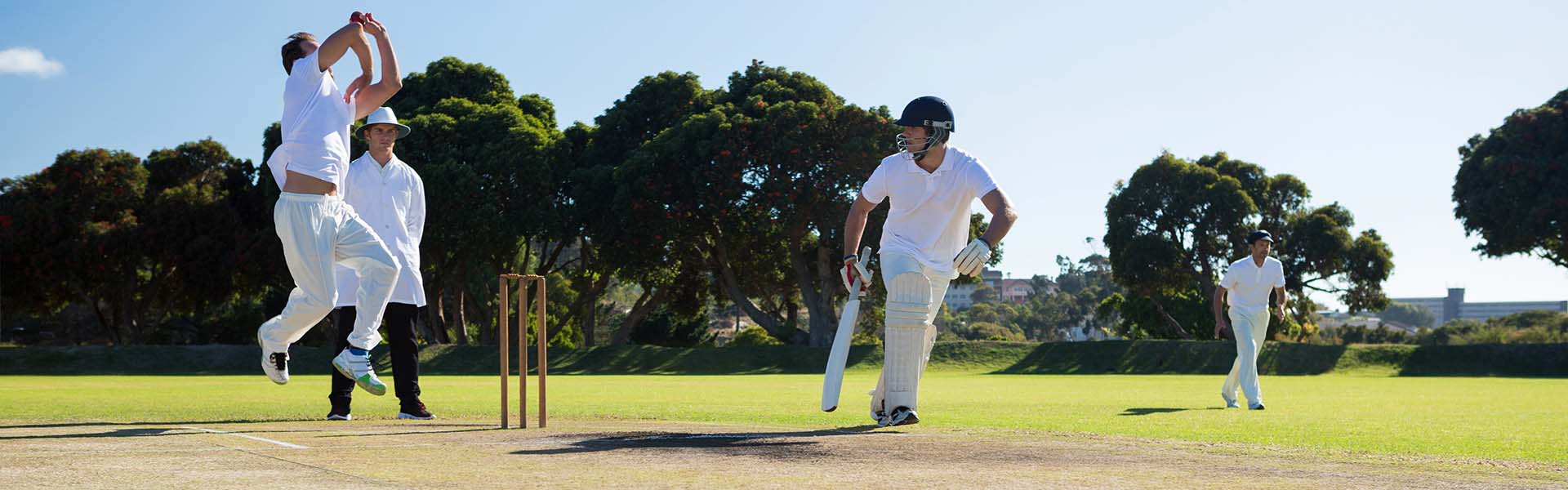 Playing cricket match, delivering the ball