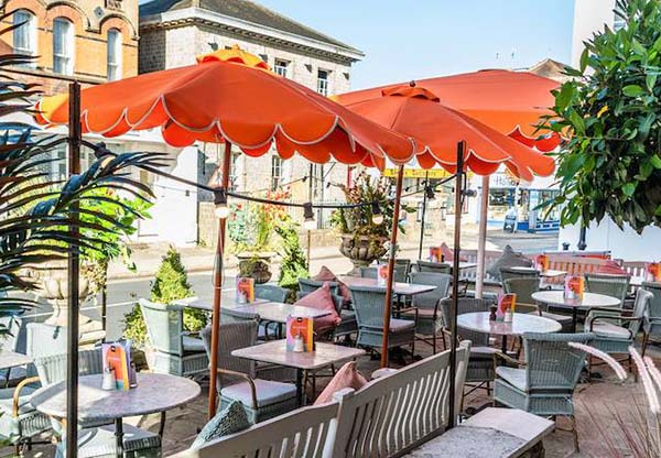 View of outside tables and umbrellas outside terrace