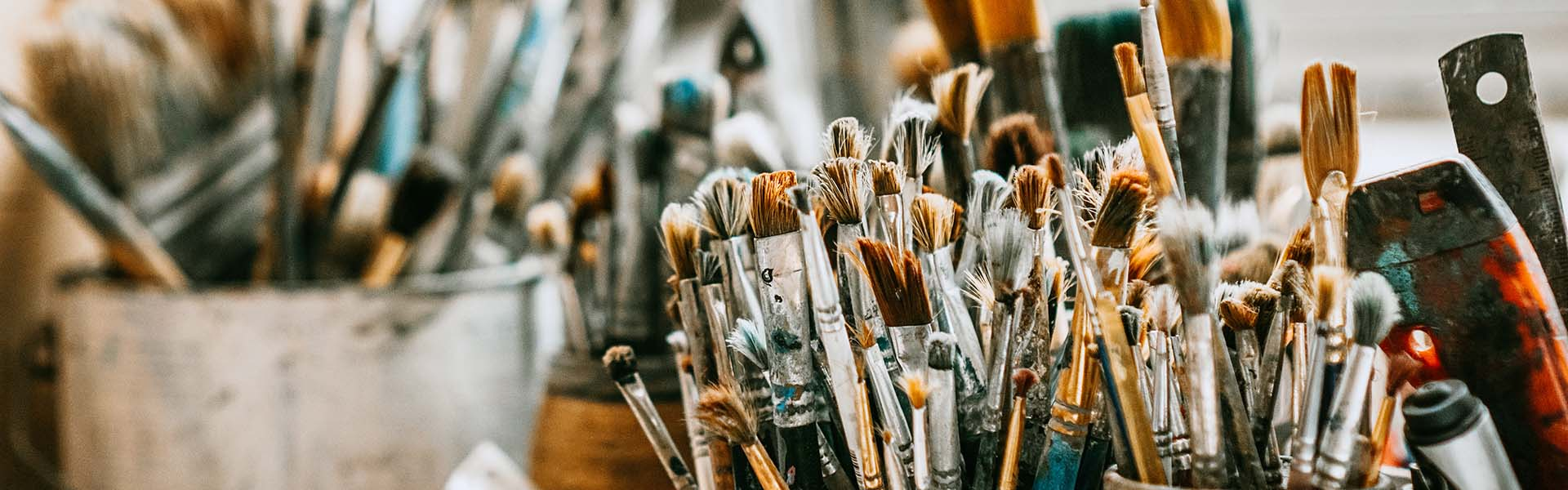 Table with brushes and tools in an artist's studio